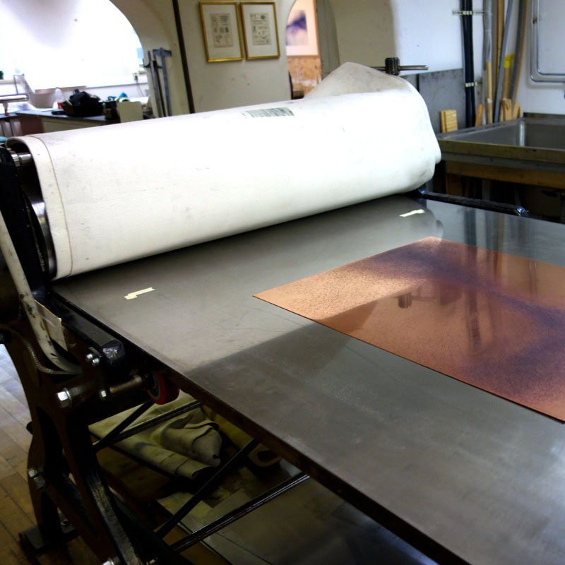 Essential parts of the printing process: printing press, paper and a copper plate