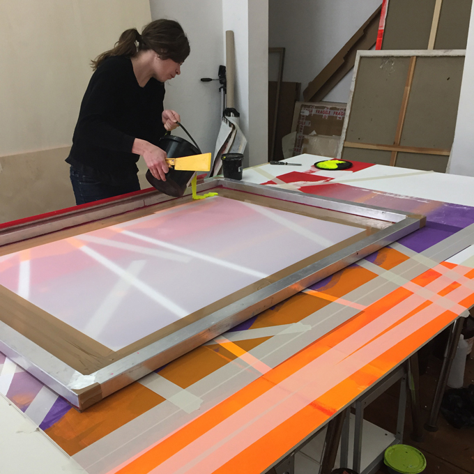 View of the studio, screen printing on plywood